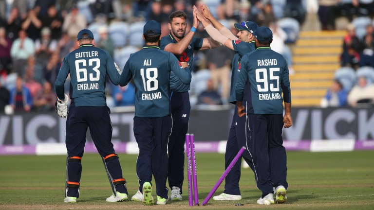 Liam Plunkett (centre) celebrates the crucial wicket of Shaun Marsh in Cardiff
