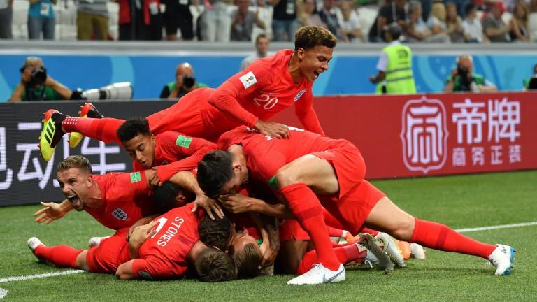 England players celebrate Harry Kane's opener against Tunisia