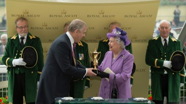 The Queen receives the Gold Cup from her son the Duke Of York after Estimate's victory in 2013