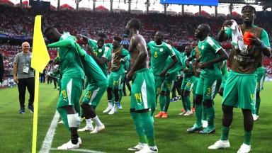Senegal celebrate a goal against Poland and acknowledge fans