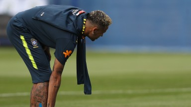 Neymar Jr reacts during a training session in Sochi
