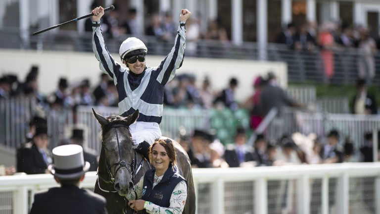 Alpha celebrations: Colm O'Donoghue raises his arms aloft following the imperious success of Alpha Centauri in the Coronation Stakes