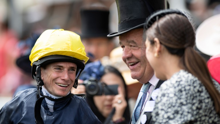 Miles of smiles: jockey Ryan Moore and trainer Sir Michael Stoute enjoy Crystal Ocean's success