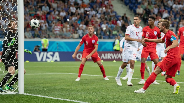 Harry Kane heads in to score England's late winner against Tunisia