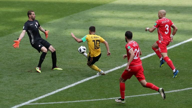 Belgium's Eden Hazard dribbles past the Tunisia goalie