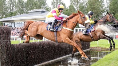 More Buck's (nearside) on his way to winning the featured 3m handicap chase