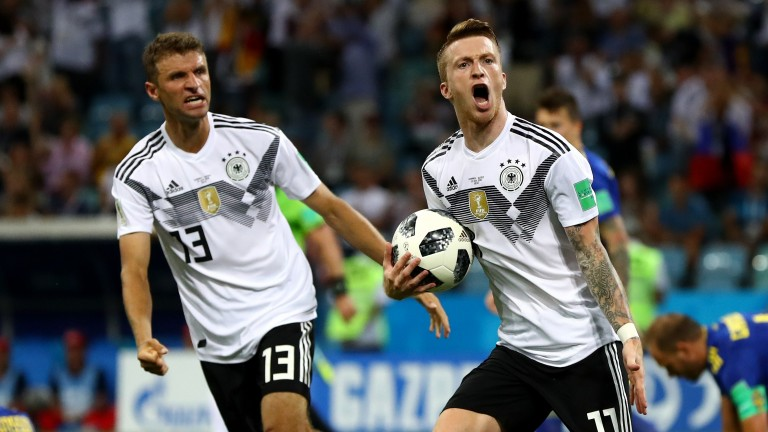 Germany's Marco Reus celebrates with Thomas Muller