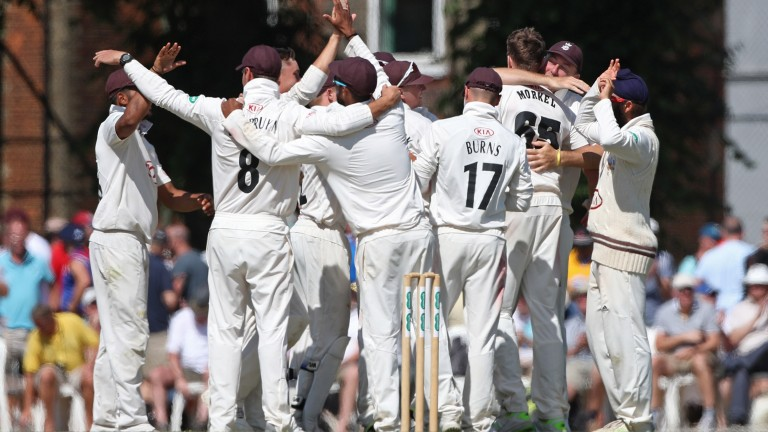 Surrey players celebrate their success over Somerset at Guildford