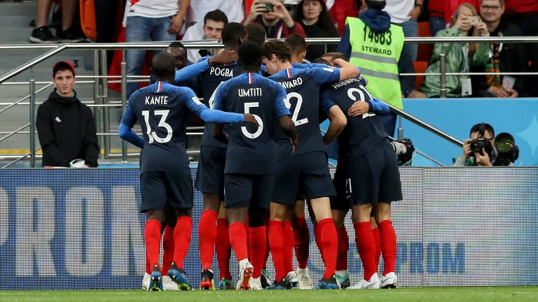France celebrate clinching qualification from Group C with a 1-0 victory over Peru