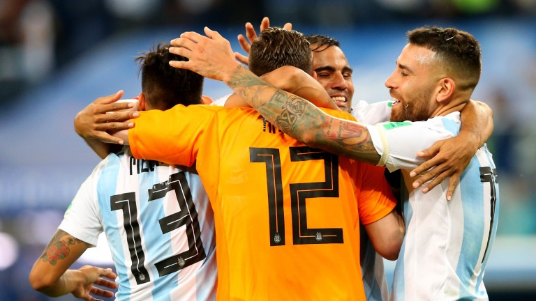 Argentina players celebrate their victory over Nigeria