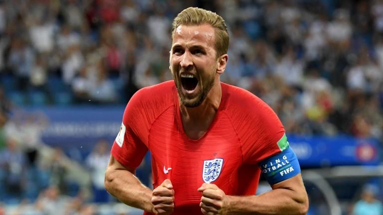 England captain Harry Kane celebrates scoring against Tunisia