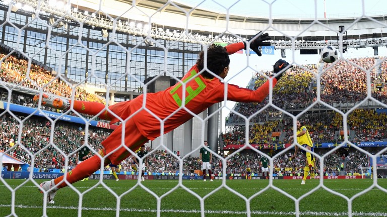 Andreas Granqvist of Sweden scores his team's second goal from the penalty spot against Mexico