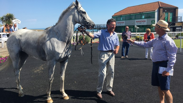 Roy Rocket and his devoted trainer John Berry bask in the Brighton sunshine last week