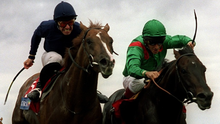 Giant's Causeway and George Duffield (left) battle it out with Kalanisi and Pat Eddery in the 2000 Coral-Eclipse Stakes