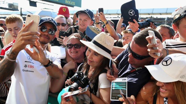 Fans grab a selfie with Lewis Hamilton at Silverstone