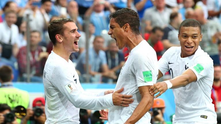 Raphael Varane (middle) celebrates France's opening goal