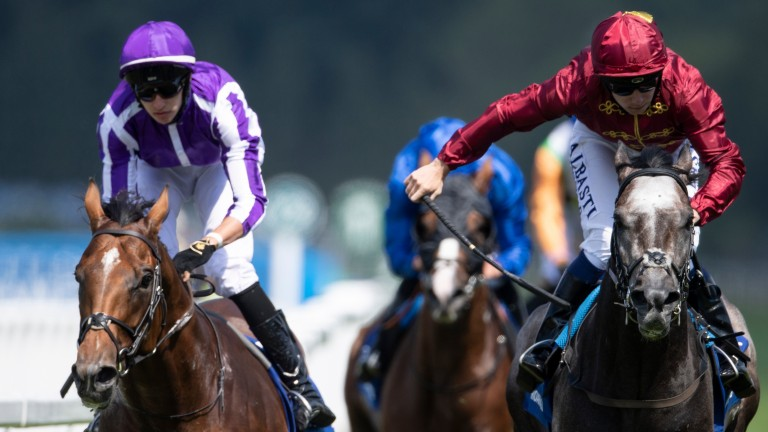 Roaring Lion (right) sweeps past Saxon Warrior to win the Eclipse