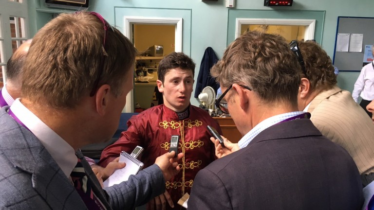 Oisin Murphy debriefs the press in Sandown's weighing room after winning the Coral-Eclipse