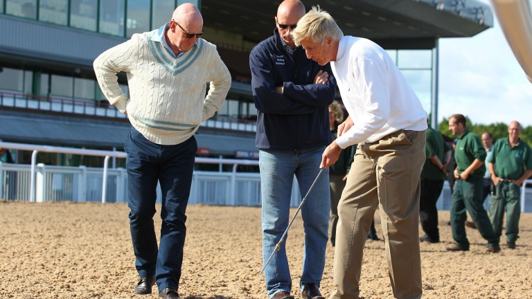 Jim Allen (centre) with Michael Dickinson (right) inspect the new Tapeta surface at Wolverhampton four years ago