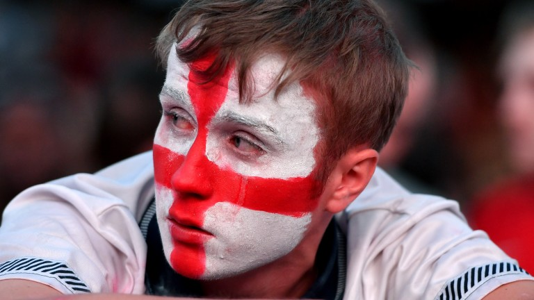 Football fans react as they watch England lose to Croatia