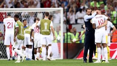 Gareth Southgate embraces Marcus Rashford after England's defeat to Croatia