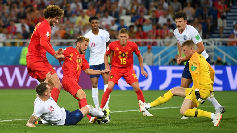 Phil Jones tackles Dries Mertens during the England-Belgium group stage game