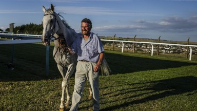 BRIGHTON, ENGLAND - JULY 10:  Trainer John Berry with Roy Rocket Brighton Racecourse on July 10, 2018 in Brighton, United Kingdom. (Photo by Alan Crowhurst/Getty Images)