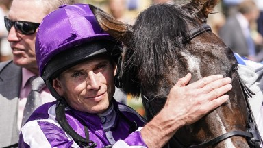 Ryan Moore gives US Navy Flag a pat after the horse ran up to his previous best rating when landing the July Cup