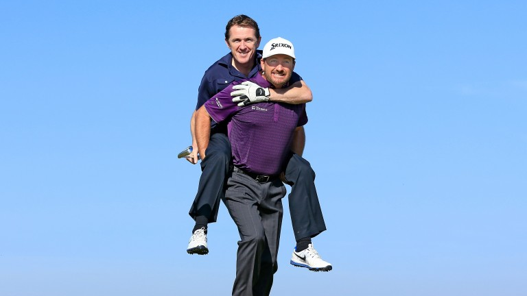 Sir Anthony McCoy is given a lift by playing partner Graeme McDowell