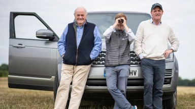 Assistant trainer Tom Ward is flanked by two generations of Hannons, Richard snr and Richard jnr, on the gallops