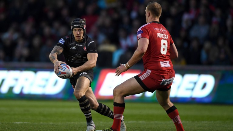 Scrum-half Theo Fages (carrying ball) is back from a hip problem for St Helens
