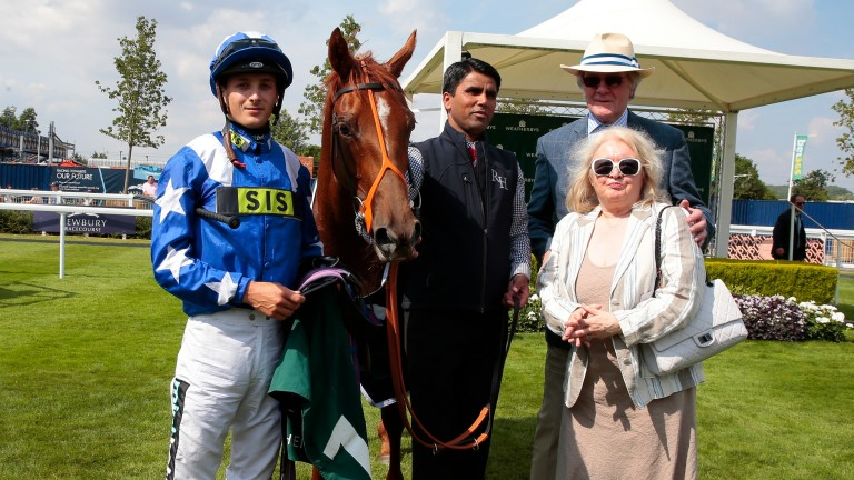 Heroic's owners Christopher and Jenny Powell with Ginger Nut, Harry Bentley and groom Babu Singh after victory in the Weatherbys Super Sprint at Newbury