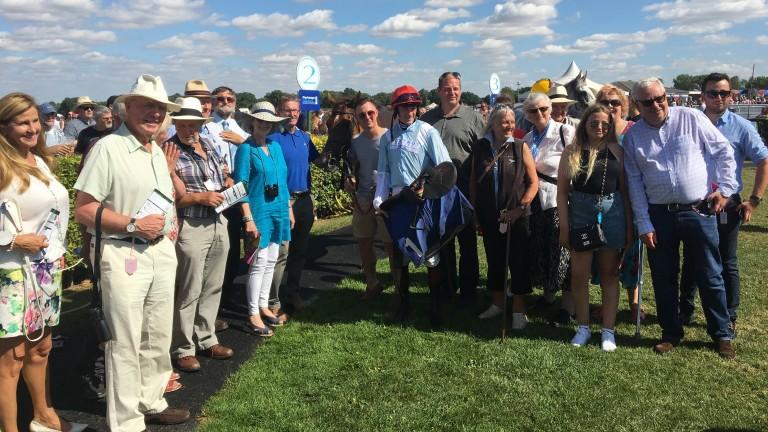 Members of the Foxtrot Racing Partnership celebrate big-race success