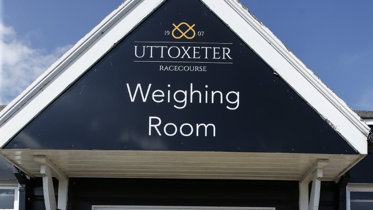UTTOXETER, ENGLAND - JUNE 06:  Jockey Andrew Thornton leaves the weighing room with agent Dave Roberts on his last days race riding as he retires after the meeting having ridden over 1,000 winners during his career, at Uttoxeter Racecourse on June 06, 201