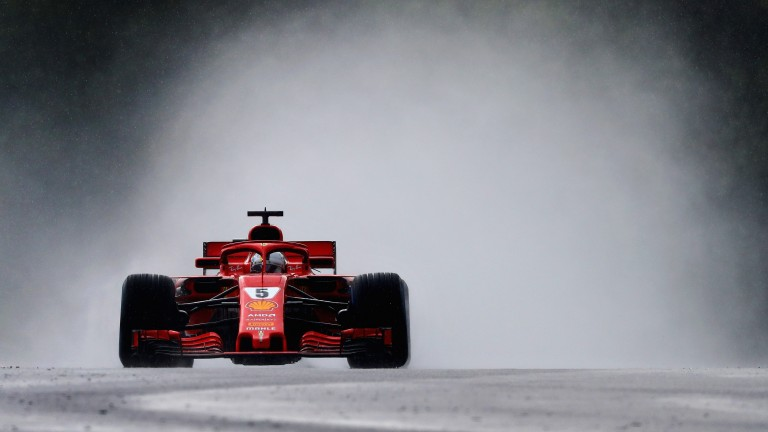 Sebastian Vettel sends the spray flying during qualifying for the Hungarian Grand Prix