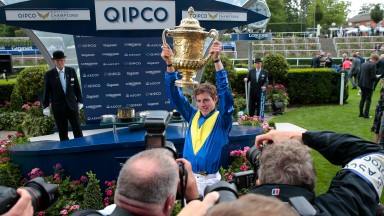 James Doyle holds up the trophy after winning with Poet's WordThe King George VI And Queen Elizabeth Stakes (Sponsored By Qipco) (Group 1) (British Champions Series)Ascot 28/7/2018©cranhamphoto.com