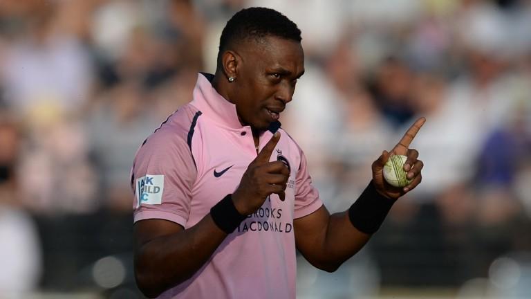 Dwayne Bravo celebrates a wicket for Middlesex
