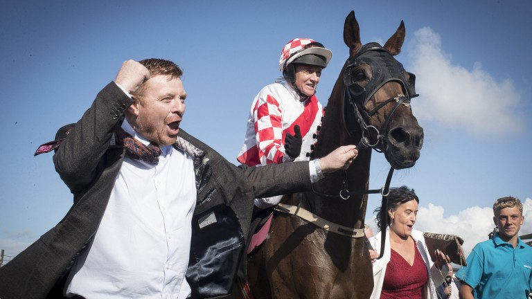 What it means to have a winner: owner Kevin McConnell punches the air as he leads in his winner Storm Rising and Barry Geraghty after their victory in the 2m½f handicap hurdle