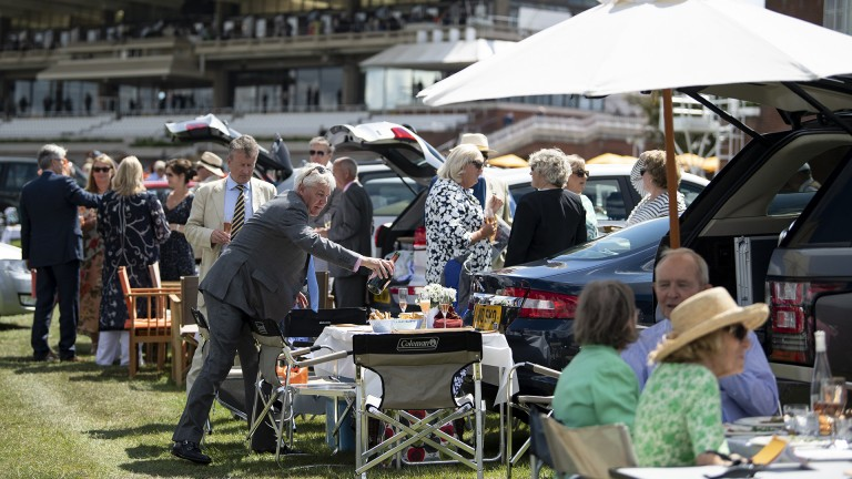 Picnic party: racegoers enjoy a drink and bite to eat in car park three before racing