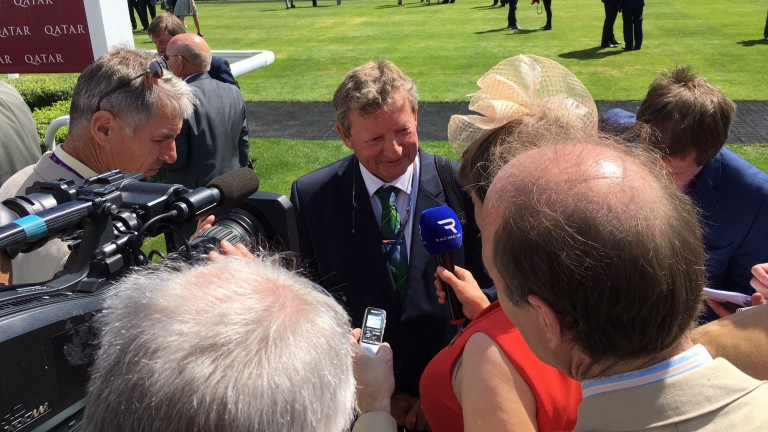 Mark Johnston is surrounded by the media after Dark Vision's win