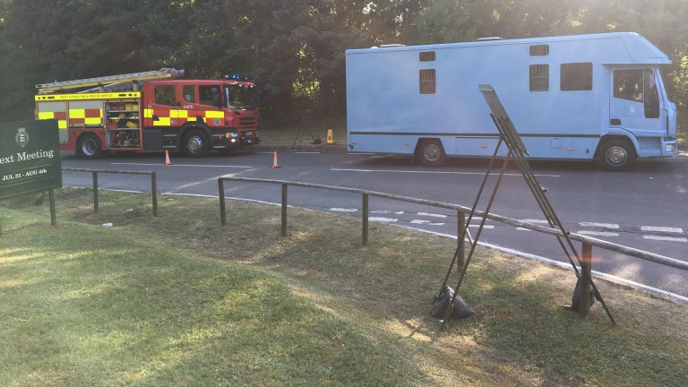 The fire brigade assesses the stricken horsebox at Goodwood