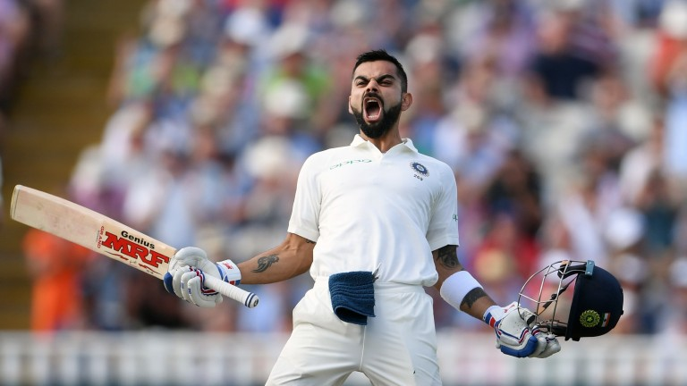 India's Virat Kohli celebrates his century against England