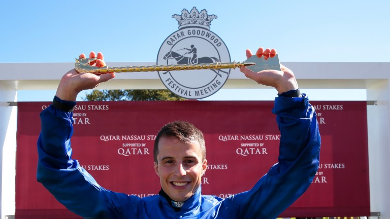 William Buick: celebrates by displaying his golden whip trophy after winning the Nassau