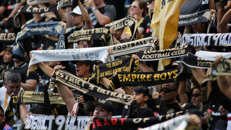 Los Angeles FC fans raising their scarves