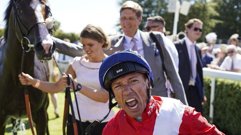 Frankie's back: Frankie Dettori is in celebratory mood after his victory on Regal Reality at Glorious Goodwood
