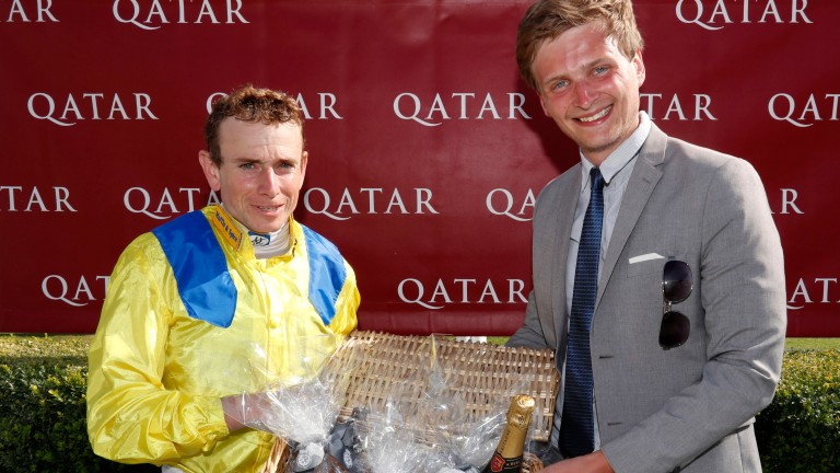 Racing UK's Anthony Dunkley presents Ryan Moore with his prize