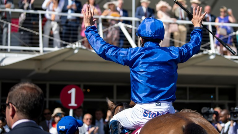 William Buick celebrates as Wild Illusion comes back in after winning the Nassau Stakes