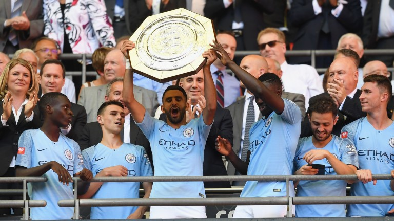 Man City celebrate winning the Community Shield