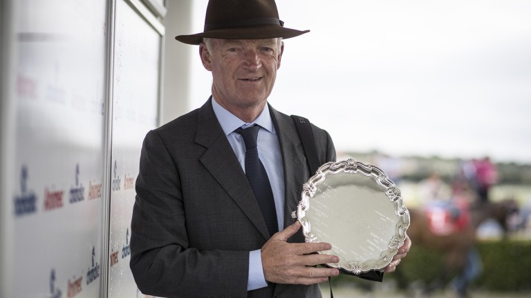 Another for the trophy cabinet: Willie Mullins poses with his prize after finishing the leading trainer at the festival