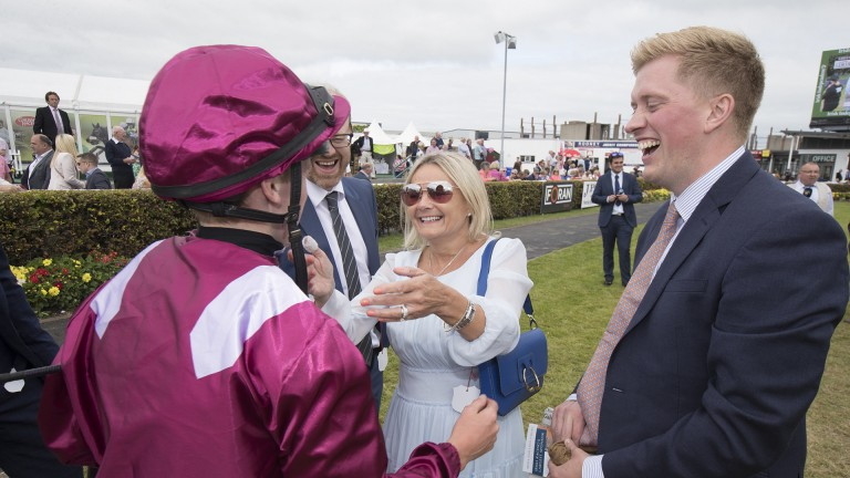You beauty: Sean Davis accepts the congratulations of connections after his victory on Safe Voyage in the Ahonoora Handicap
